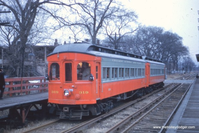 On December 7, 1958, CA&E wood cars 319 and 320 operated the last passenger train on that venerable railroad as a charter. Here, we are at Fifth Avenue station looking east. After the CTA abandoned the Westchester branch, this station was repainted in CA&E colors, and the interurban took over all service here from 1951-57.