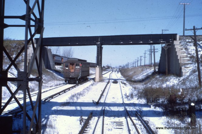 A single Westchester car passes under the Illinois Central near the Roosevelt Road station.