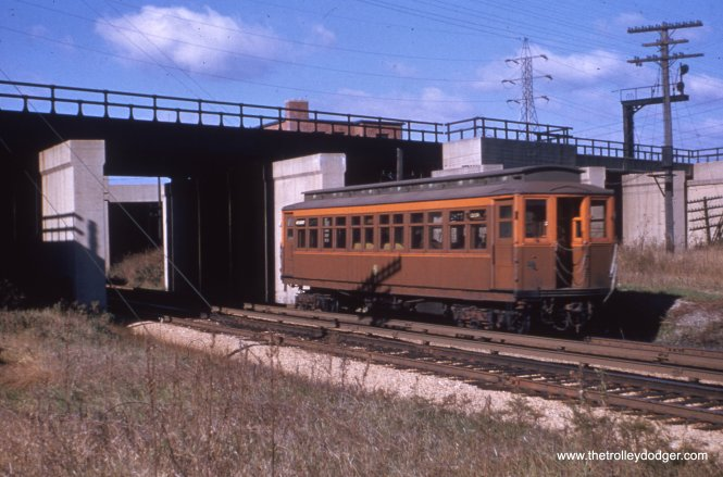 A westbound Westchester car passing under the Indiana Harbor Belt. The two lines were grade separated in 1930-31. This is now the site of the Illinois Prairie Path.