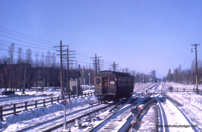 The passing tracks in this photo are a clue that we are near the Gunderson Avenue station in Oak Park. The Forest Park gas tank is at rear, so we are looking west.