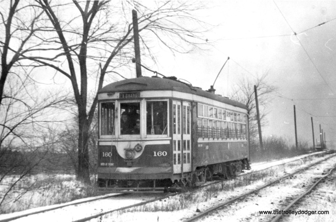 The Chicago & West Towns Railways also had some private right-of-way in the western suburbs. Car 160 is shown near LaGrange in December 1945.