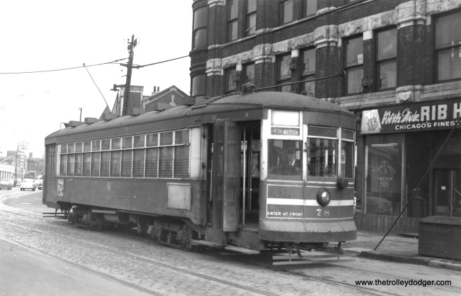 "CTA 78 is shown at the east end of the Madison-Fifth shuttle in February, 1954. But wait-- wouldn't car 78 be on the Hammond, Whiting, and East Chicago? According to Alan R. Lind's CSL book, the CTA renumbered car 1780 to 78 in the waning days of red car service, in order to free up numbers in the 1780s for some buses. This was the only time a CSL streetcar was given a two-digit number, except for work cars. That's one school of thought. On the other hand, the number on the side of this car looks like 1781, and according to Andre Kristopans, it was still 1781 when scrapped. It may in fact not be a renumbering at all, just a case where either the car's paint got touched up and obscured part of the number, or part of the number fell off and did not get replaced, since red car service was ending in a few months anyway. At left in the background you can see Fohrman Motors, a Chicago car dealer from 1912 to 1979. Three people were killed at the dealership by a disgruntled customer on January 7, 1966. The neighborhood, not far from the construction site for the Congress (now Eisenhower) expressway, is already showing signs of urban decay. We discuss this in our post Some Thoughts on ""Displaced"" (August 30, 2016)."