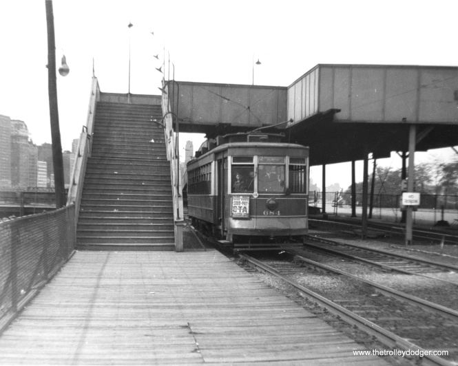 "CTA 684 at the ""Museum Loop,"" the eastern terminal of Route 12. Lake Shore Drive and the Field Museum are to the right, with the Illinois Central tracks at left."