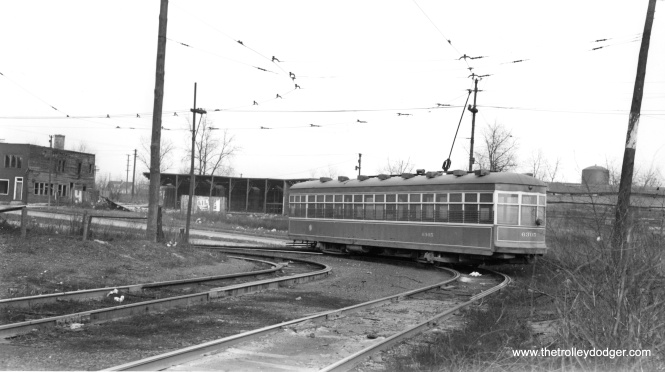 "Bob Lalich writes, ""CTA 6305 is turning north about to leave the private right of way just south of 94th St and enter the median of Stony Island. The water tank in the right distance was located on the BRC near their South Chicago engine house."" (Joe L. Diaz Photo)"