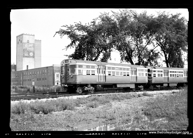 CTA 6051-6052 at the DesPlaines Avenue terminal in the 1950s. The Acme Feeds (7715 W. Van Buren) towers at are at the background. Among other things, they sold a product called Acme Worm Bouncer. After being abandoned for many years, the towers caught fire in 1980 and were demolished.