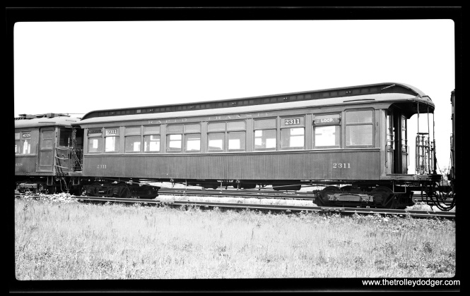 This picture presents somewhat of a mystery. Car 2311, signed for Westchester, is identified as being in Maywood on July 21, 1934, with a 4000-series car behind it. There were some storage tracks east of First Avenue, but I am not sure whether CRT used these. Or perhaps these cars are near DesPlaines Avenue.