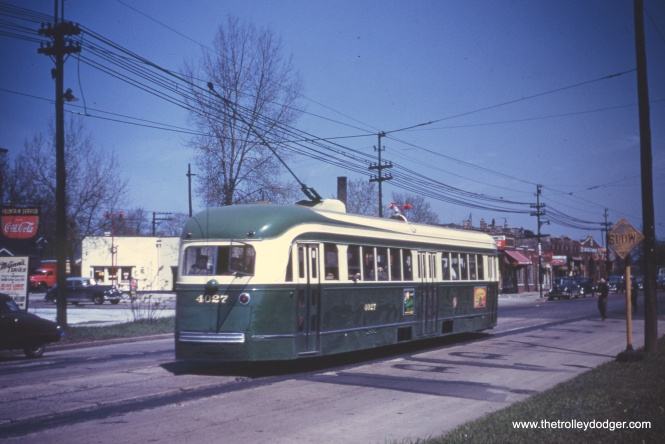 "Prewar PCC 4027 at an unknown location. Likely possibilities are routes 4, 49, or 63. Tony Waller writes, ""Image 243 is on 63rd St. Look at the pre-war PCC. It's door arrangement is that of a two-man car. Cottage Grove and Western only had pre-war PCCs in one man operation."""
