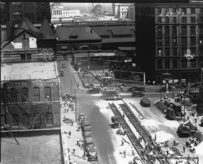 "The Roosevelt Road extension to the World's Fair site is under construction in this June 24, 1933 view. The Illinois Central station lies between here and what we now call the ""Museum Campus."""