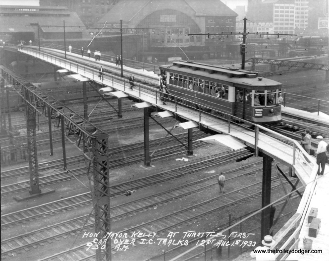The first service car over the Illinois Central viaduct, with Mayor Kelly at the throttle, in a picture taken at 9:30 am on August 1, 1933.