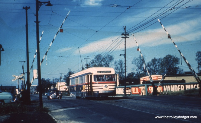 "Here, we are at about 4600 west 63rd street looking west. Car 4013, heading east, wears the CSL ""tiger stripes"" introduced in 1945. Bill Shapotkin adds, ""That caption is correct. I might add that ""is"" at 4600 West and the tracks are those of the BRC. By the way, as an aside, if you ride the Rt #63 bus, the stop here is called out as ""4600 West."" No street name (which would otherwise be Kenton) is given."""