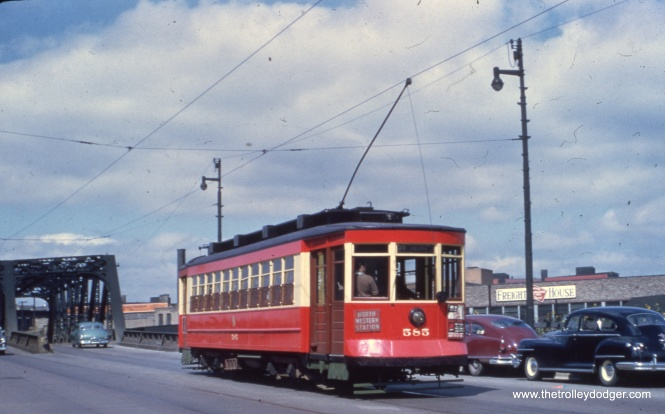 "Car 585 on route 56 - Milwaukee near Downtown. Bill Shapotkin adds, ""This pic of a Milwaukee Ave streetcar is at the Milwaukee Ave bridge over the MILW/PRR near Des Plaines St. Believe the view looks N/W. Note the long-standing MILW freight house on the right."""