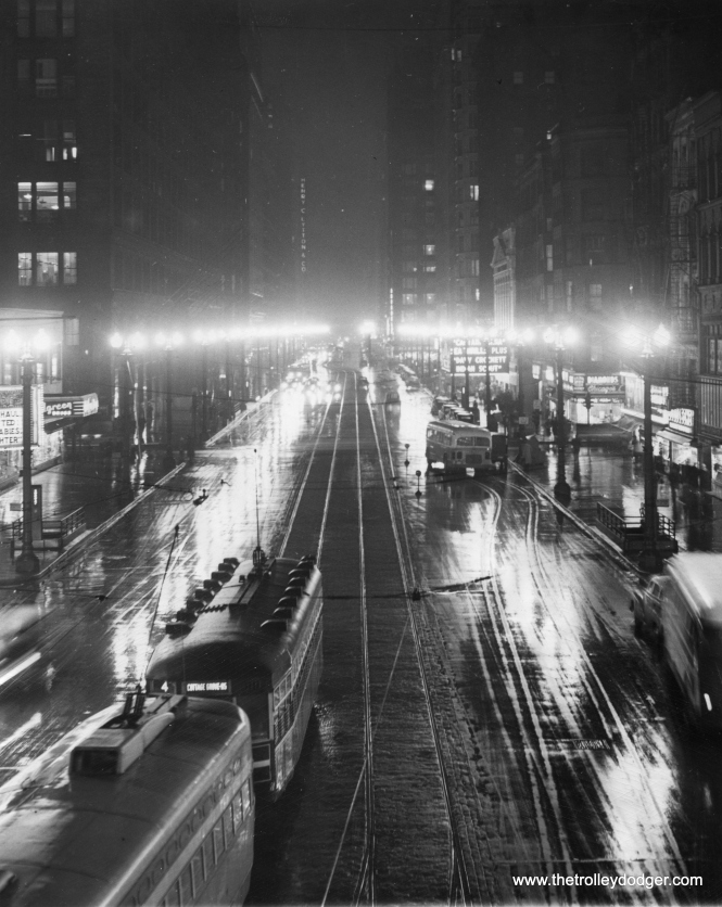 "It's February 22, 1950, looking south on State Street. ""Chicago's famed State Street gleams with all its brilliance before half of the lights were turned off to save fuel as the Coal strike cuts Illinois's output of coal 95 per cent. The State Street Lighting association began a 50 per cent voluntary dim-out of the street to save meager fuel supplies. The PCC is on route 36 - Broadway-State, while the Peter Witt is on route 4 - Cottage Grove."