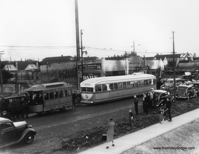 "It's August 28, 1936 on north Ashland Avenue, and time for a parade. One week earlier, streetcar service had been extended north of Cortland in one of the final extensions under CSL. Prior to this time, this portion of the route had run on Southport, two blocks to the east. North Chicago Street Railroad ""Bombay roof"" horsecar 8 is ahead of the experimental 1934 Brill pre-PCC car 7001. Ironically, the older car survives at the Illinois Railway Museum, while 7001 was scrapped in 1959. On the other hand, Mike Franklin writes: ""Dave, the top photo is taken at 8537 S. Commercial, Chicago. Schmidt Cleaning and Dying. It is not Ashland Ave. Do Google Earth and it all makes sense."" If you are correct, then this picture was probably misidentified, and the parade actually took place around May 2, 1937, when the east and west portions of the 87th Street route were connected via a through route. Thanks for your detective work."