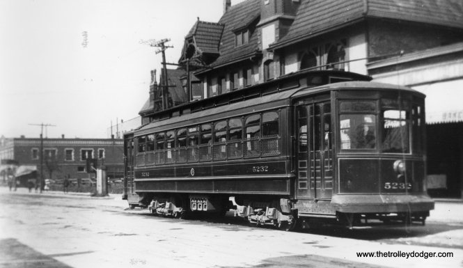 "Roy Benedict writes, ""Chicago City Railway car 5232 is on 51st St. at Grand Blvd. (now King Dr.) as evidenced by the distant building, which appears in later photos. The car tracks ended at the boulevard then and for a couple of decades later."" This photo must predate 1914, when the Chicago Surface Lines came into being. According to Don's Rail Photos, ""1st 5201 thru 5250 were built by Brill-American Car Co in 1906, (Order) #15365, for CCRy as 5201 thru 5250, but it was shipped to United Railroads of San Francisco due to the earthquake. 2nd 5201 thru 5250 were built by Brill-American Car Co in 1906, (Order) #15365, to replace the orignal order. They were rebuilt in 1909 to bring them up to the standard of the later cars."""