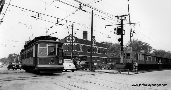 Car 2721 crosses the Illinois Central Electric at 79th Street and Exchange Avenue. (Joe L. Diaz Photo)