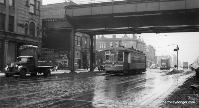 "In this slushy winter scene, car 3266 is southbound on State below 59th, passing under the ""L"". (Joe L. Diaz Photo)"