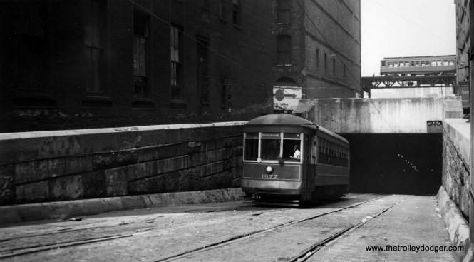 "Car 1677 is most likely being used for training in the Van Buren tunnel under the Chicago River in this scene. The Met ""L"" is in the background. (Joe L. Diaz Photo)"