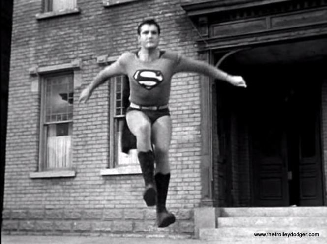 To simulate flight, actor George Reeves would jump on some sort of springboard just out of view at the bottom of the screen, then leap over the camera and land on some mattresses. He got very good at this sort of thing.