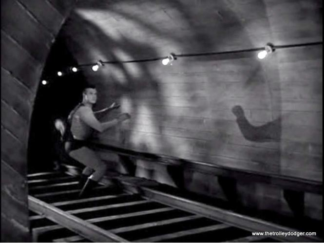 Superman lands in the subway tunnel.