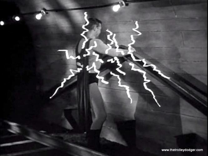 Superman vs. third rail.  Guess who wins?  Special effects here are some squiggly lightning bolts painted onto the film.