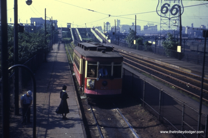 A woman prepares to board CTA 229 at the Museum Loop on June 24, 1951