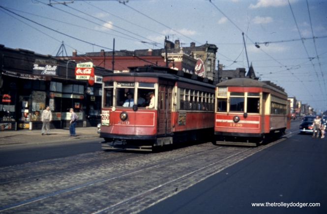 "Cars 269 and 1736 pass. One car is signed for route 52 - Kedzie; however, the slide says this is 2800 W. Chicago Avenue. The date is May 4, 1952. Andre Kristopans writes, ""CTA 269 and 1736 are indeed at 2800 W Chicago Av. 52 cars used four blocks of Chicago to go between California and Kedzie. The left-hand turnoff to go north on California is right in front of 1736."""