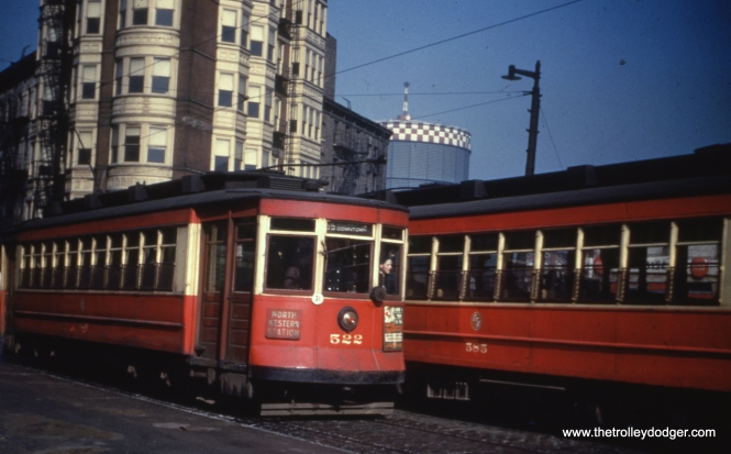 "Car 522, signed for route 56 - Milwaukee, passes 585. Andre Kristopans says, ""The gas holder is the one at Augusta and Grand. This would make the most likely spot Milwaukee and Carpenter."""