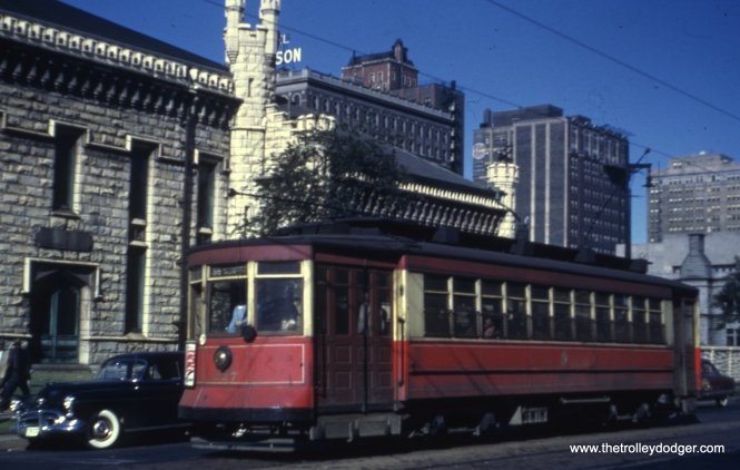 Car 227 at Chicago and Michigan, passing by the historic Water Tower and pumping station.