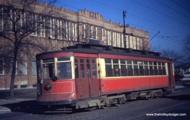 CTA 282 at Belmont and Lavergne in 1949, passing Foreman High School.