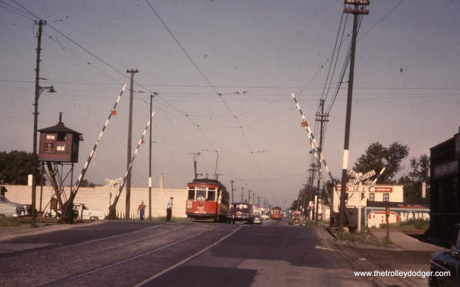 CTA 460, eastbound at about 4600 W. 63rd Street, crossing the Belt Railway circa 1952-53 after PCCs were taken off this route. This car is preserved at the Illinois Railway Museum.