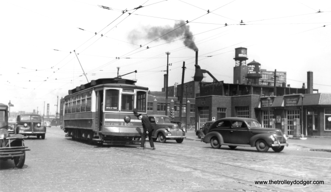 "CSL 1408 at Ashland and Fulton in May 1946. Andre Kristopans adds, ""note two things here – operator of car (not motorman, as this is a one-man car) has thrown the manual switch to continue east on Fulton, and note the trolley wire is a gauntlet between the two Fultons with a crossing frog, not a switch."" (Robert W, Gibson Photo)"