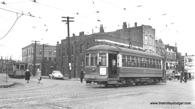 "Andre Kristopans says,""1560 is a pull-in to Blue island car house going west on Blue island at Leavitt – car in background is at the south end of 18th St line on Leavitt at Blue Island."""