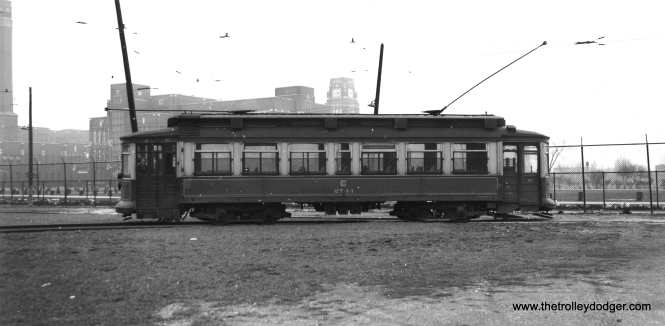 """According to Andre Kristopans, """"CSL 2744 is at Roscoe and Western loop. The big building in background is Lane Technical High School. Car is probably running a Lincoln-Roscoe trip, as the side sign is blank. Note that since the earlier shot on 79th car has migrated to a different carbarn!"""" (Joe L. Diaz Photo)"""