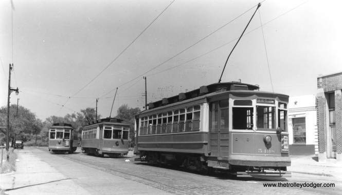 """According to Chuck Amstein, CSL 5347, 5351, and 5438 are """"at the north end of the Ashland line at W. Warner Ave. and N. Southport Ave., looking NNE towards Graceland cemetery. The street sign at center left looks like it could be Warner. The destination sign on car 5438 probably was already changed for the southbound run."""" (Joe L. Diaz Photo)"""