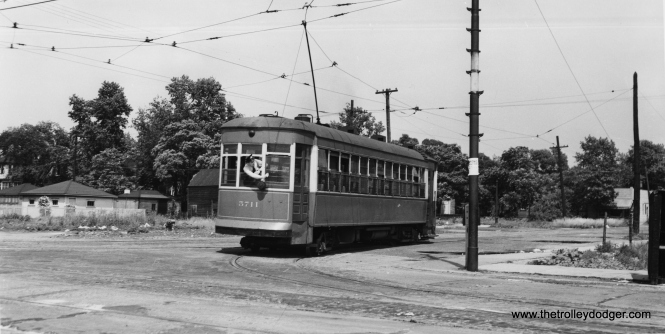 """CSL 5711 turning from 108th onto Ewing. Bob Lalich says, """"CSL 5711 looks to be backing onto Ewing from 108th. This spot was a transfer to the Brandon-Brainard line. The transfer location was later moved to 118th St."""" (Joe L. Diaz Photo)"""
