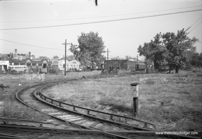 "Image #801 shows the Kimball Yard on the Ravenswood ""L"", today's Brown Line, looking northwest. It's hard to imagine it looking like this, considering how tight space is in this yard today. A southbound Kimball bus (a Brill 2000-series) is at left, and the date is circa 1949. Check out the duck pond."