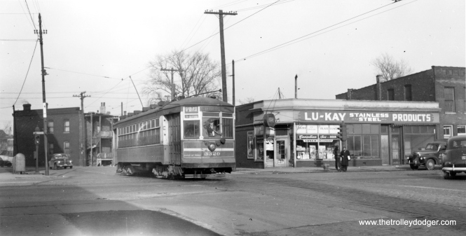 "CSL 3320 on the 67-69-71 route, ""crossing South Chicago Av on Anthony,"" according to Andre Kristopans. On the other hand, Bob Lalich says, ""CSL 3320 is crossing South Chicago Ave on a very short street called Keefe Ave. which goes under the NYC/PRR elevation in a viaduct. Anthony runs parallel to the NYC/PRR elevation on the south."""