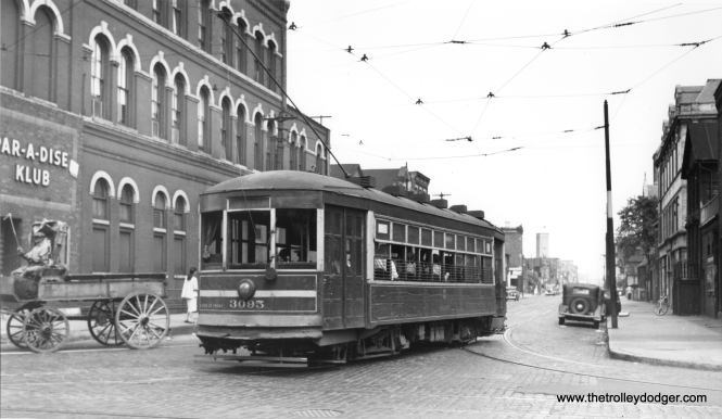 "CSL 3095 is ""NB turning off 21st onto Racine on Morgan-Racine-Sangamon route,"" according to Andre Kristopans. Note the horse-drawn wagon near the Par-A-Dise Klub at left."