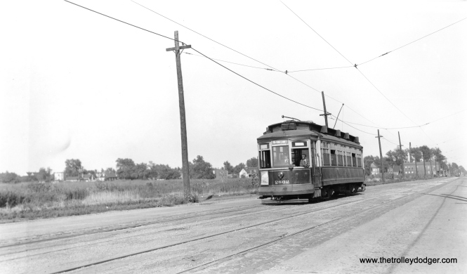 "CSL 2802 is westbound on 119th Street. Andre Kristopans says, ""a block or so west of Morgan, about where the new Salvation Army center now is. Looks like a State/Lake car in the far background at Morgan."""