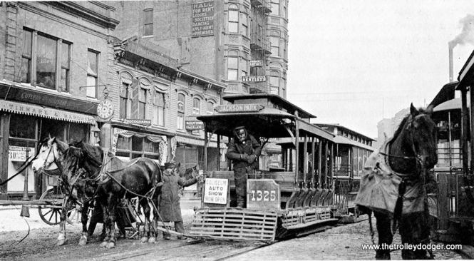 This old Chicago Daily News photo is identified as being at the end of a cable car route, where horses were used to move the cars around. However, the Chicago Auto Show is being advertised, which would help date this photo. This car is #1325.