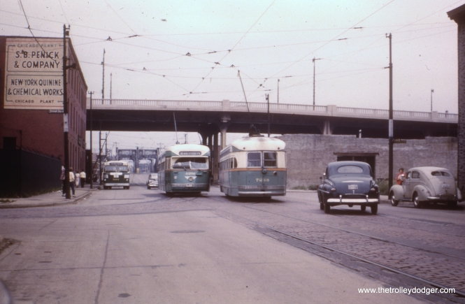 "According to Andre Kristopans, ""#3 is looking west on Division at Crosby. Cars are on detour via Halsted-Division-Crosby-Larrabee-Chicago-Halsted."" The Ogden overpass, since demolished, is at rear."