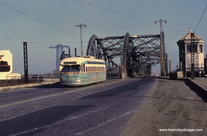 "#26 - Andre Kristopans says, ""Western at the North Branch – old bascule bridge that was replaced about 1968 or so."" Bill Wasik adds, ""View north toward the old red towers at the Riverview entrance. The Pair-O-Chutes tower can be seen at the left."""