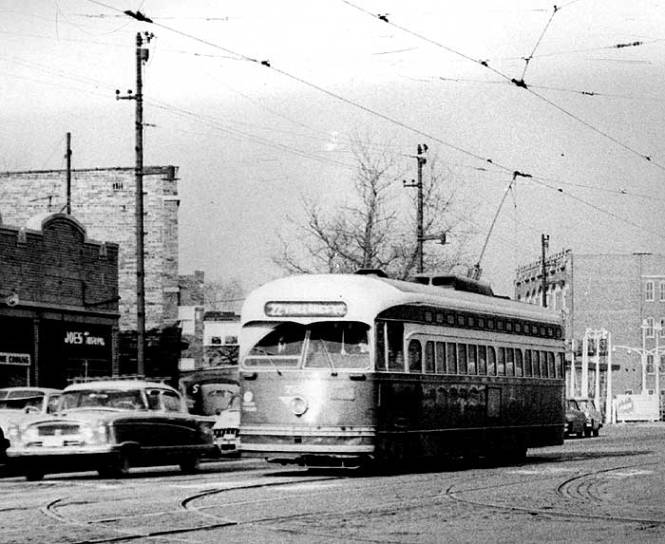 Southbound 22 car at Vincennes passing near the main shops at 77th. Not the best shot due to the grain but still a shot of the final streetcar line in Chicago. © Laurence Mack