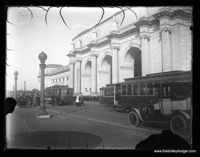 DC streetcars at Washington Union Station, designed by Daniel Burnham. It opened in 1907. From a glass plate negative.