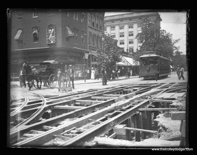 A turn-of-the-century view of Washington, D. C., showing how streetcars were powered by an underground conduit. From a glass plate negative.