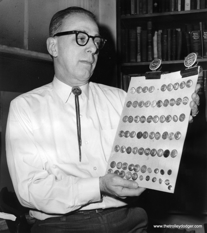 Owen Davies exhibiting collection of railroad buttons and metal passes in his quaint store at 1214 N. LaSalle St.