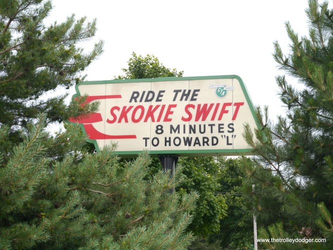 The Skokie Swift, or Yellow Line as it is now called, doesn't make the trip between Howard and Dempster in 8 minutes right now, since the embankment gave way last month. Press reports say it will be out of action until October, but meanwhile this old sign is a reminder of swifter days that once were.
