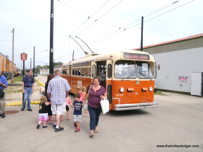 While in general railfans like to take pictures without anyone in them, this shows that people enjoyed riding the Milwaukee trolley bus.