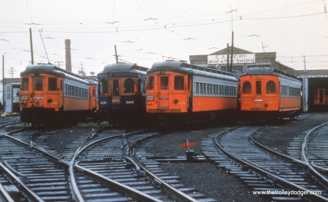 #12 - FH: Nice shot at Wheaton, I'm guessing taken during the 310 fantrip. The 315 must have been one of the last 300-series wood cars in blue. Note the rebuilt Pullman in the shop at right.