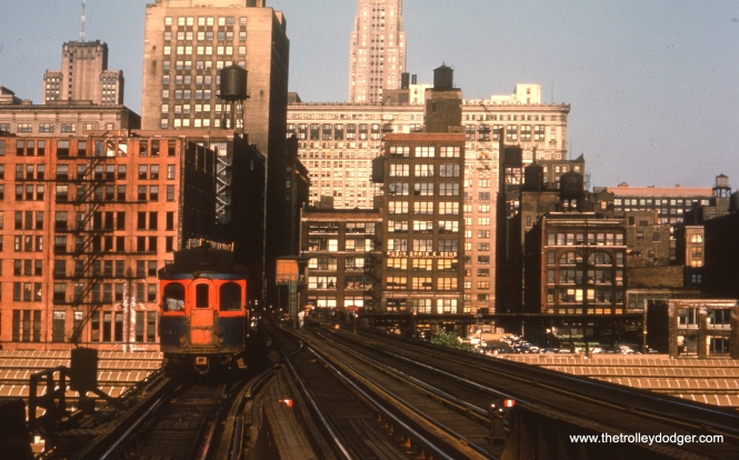 #28 - EM: One of the ex-North Shore Line wooden cars leads a westbound train over Union Station headed for Canal Street station. The train came from the Wells Street station through the tall buildings. The tracks curving off to the right lead to the CTA station at Franklin and Van Buren. All these tracks saw heavy traffic until September of 1953.